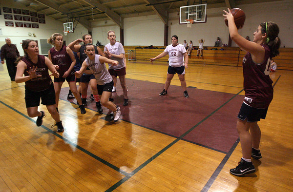 Rockport: Heather MacArthur looks for an open teammate as the Rockport varsity and junior varsity scrimmage during practice yesterday. Their game against Essex Aggie was postponed for the second time due to weather. It is now scheduled for next Wednesday. Photo by Kate Glass/Gloucester Daily Times