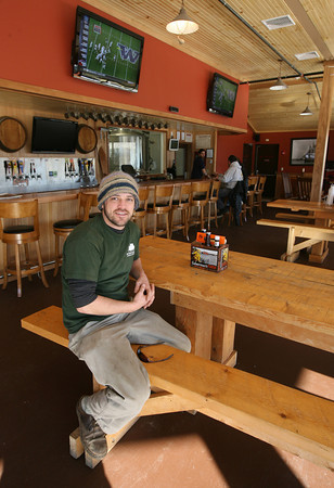 Gloucester: Dylan L'Abbe-Lindquist, General Manager of Cape Ann Brewing Co. takes a seat in their new pub, which is now open next to St. Peter's Square. Photo by Kate Glass/Gloucester Daily Times
