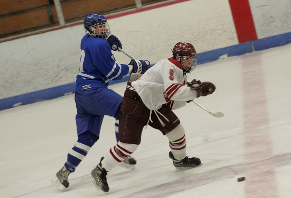 Gloucester: Danvers' Chris Milne tries to get the puck from Gloucester's Geoff Kennedy during the hockey game at Gloucester's Dorothy Talbot Rink Wednesday night. Gloucester defeated Danvers 4-3. Mary Muckenhoupt/Gloucester Daily Times
