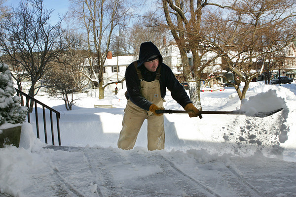 Manchester: Mark Hammond, of the Manchester DPW, clears the steps of Manchester Town Hall after about a foot of snow fell on Cape Ann  Thursday morning. Mary Muckenhoupt/Gloucester Daily Times