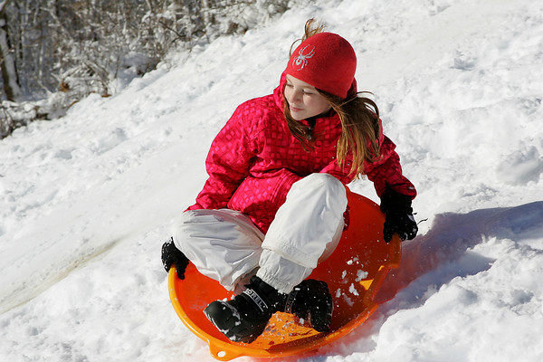 Essex: Lily Corcoran, 9, whizzes down the hill while enjoying another  snow day by sledding behind Essex Town Hall Thursday morning. Mary Muckenhoupt/Gloucester Daily Times