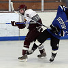 Rockport's Brendan Surette knocks Bedford's Paul Sobchenko off his skates during their 6-2 win at the Talbot Rink yesterday afternoon. Photo by Kate Glass/Gloucester Daily Times