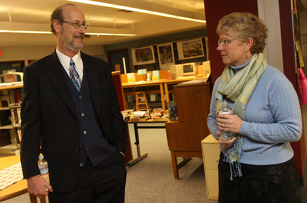Gloucester: Richard Safier, candidate for Gloucester Schools Superintendent, chats with Val Gilman, Chair of the Gloucester School Committee, during a public reception at the High School Library yesterday. Safier is the first of five finalists to be interviewed for the position. Photo by Kate Glass/Gloucester Daily Times