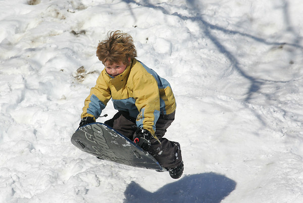 Essex: Sam Webber, 10, catches some air while sledding behind the TOHP Burnham Library Wednesday morning. Mary Muckenhoupt/Gloucester Daily Times