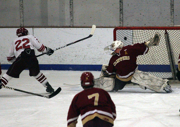 Gloucester: Gloucester's John Interrante knocks the puck past Newburyport goalie Anthony Federico on a shorthanded breakaway in the first period of their game at the Talbot Rink last night. Photo by Kate Glass/Gloucester Daily Times