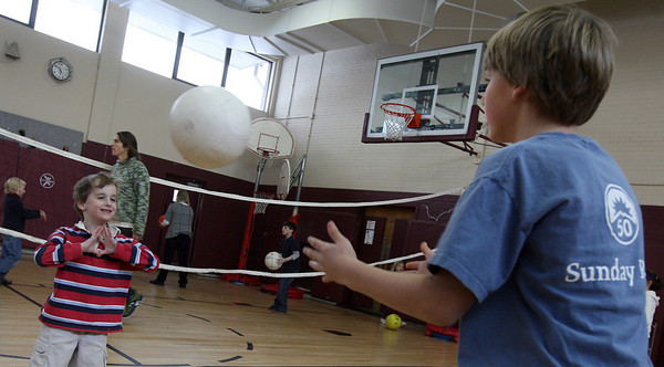"""Rockport: Colin Kelley practices his """"set"""" technique with Evan Symes during gym class on Tuesday. Photo by Kate Glass/Gloucester Daily Times"""
