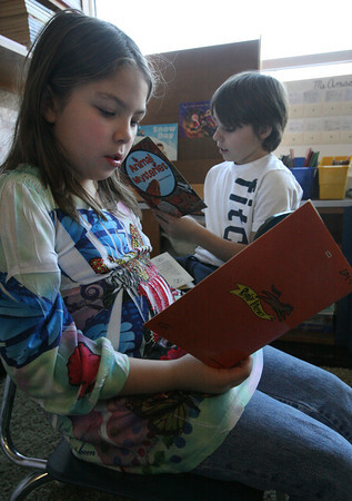 """Gloucester: Mcaela Chase and Colby Mitchell, both 4th graders, read """"Animal Mysteries"""" as part of the new reading curriculum at Beeman Memorial Elementary School. Photo by Kate Glass/Gloucester Daily Times"""