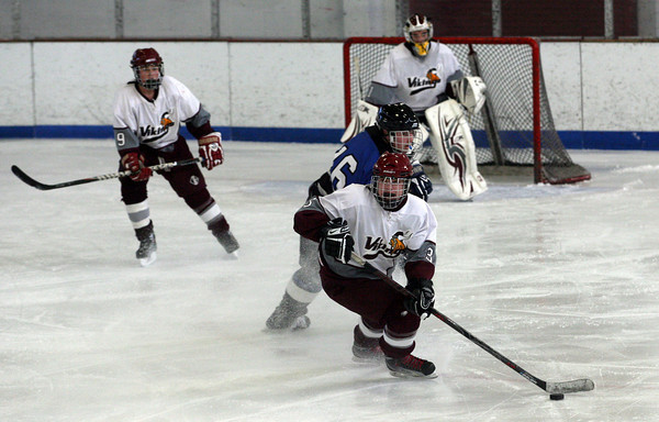 Rockport's Tucker Reedy kicks up ice as he gathers the puck during their 6-2 win over Bedford at the Talbot Rink yesterday afternoon. Photo by Kate Glass/Gloucester Daily Times