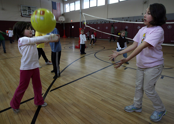 Rockport: Morgan Reilly, left, bumps the ball back to Abby Engel, right, during gym class at Rockport Elementary School on Tuesday. Photo by Kate Glass/Gloucester Daily Times