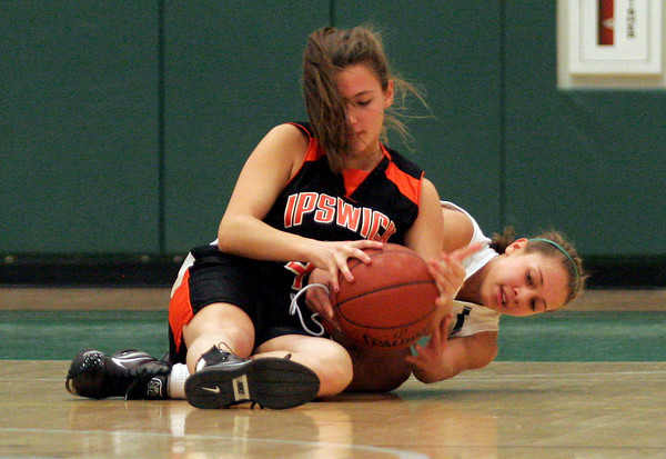 Manchester: Manchester Essex junior Jelisa O'Hara tries to pry the ball from Ipswich sophomore Natalie Soliozy during their game at Manchester Essex Regional High School last night. Photo by Kate Glass/Gloucester Daily Times