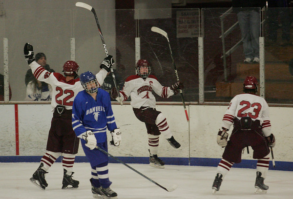 Gloucester: Gloucester's Geoff Kennedy, center, celebrates after scoring the last goal for the Fisherman during the Gloucester vs. Danvers hockey game at Dorothy Talbot Rink Wednesday night. Gloucester defeated Danvers 4-3. Mary Muckenhoupt/Gloucester Daily Times