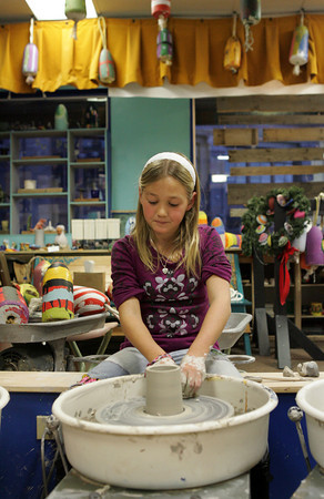 Gloucester: Rose Trotman, 8, learns to throw clay duirng a youth pottery class at Cape Ann Art Haven Thursday afternoon. Mary Muckenhoupt/Gloucester Daily Times