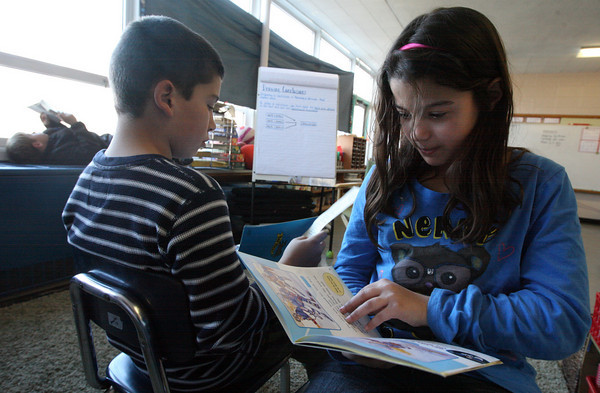 """Gloucester: Marc Smith and Bianca Costa ask each other questions after reading from """"That's Determination"""" as part of the new reading curriculum at Beeman Memorial Elementary School. The students are in 4th grade. Photo by Kate Glass/Gloucester Daily Times"""