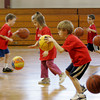 Rockport: First graders practice dribbling during youth basketball at Rockport High School Saturday morning.  The dribbling was a warm up for the kids before they went to diffrent stations to work on basketball drills. Mary Muckenhoupt/Gloucester Daily Times