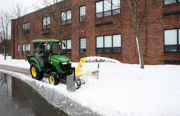 Rockport: Tom Budrow clears the walkways along Rockport Middle and High School following yesterday's storm. Photo by Kate Glass/Gloucester Daily Times