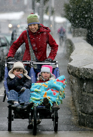Gloucester: Peggy Lyman heads down Dalev Avenue with her children Elliot, 4, and Ruby, 2, while out for a winter walk Saturday afternoon. Mary Muckenhoupt/Gloucester Daily Times