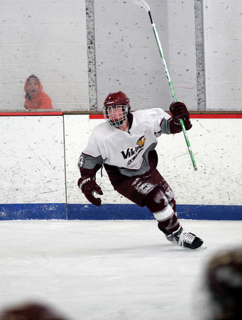 Rockport's Mike Tupper raises his stick in celebration after scoring during the Vikings' 6-2 win over Bedford at the Talbot Rink yesterday afternoon. Photo by Kate Glass/Gloucester Daily Times