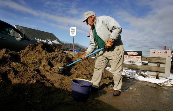 Gloucester: Joe McCormack collects some sand at the DPW yard Thursday monring to prepare for the winter weather ahead.  Snow is predicted for Friday and then a cold spell will send temperatures below freezing this weekend. Mary Muckenhoupt/Gloucester Daily Times