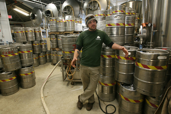 Gloucester: Dylan L'Abbe-Lindquist, General Manager of Cape Ann Brewing Co. discusses how their new space will allow them to produce more beer. Photo by Kate Glass/Gloucester Daily Times