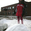 Rockport: Mya Doucette kicks a snowbank as she and her friends try to dig a tunnel through the snow during the after school program at Rockport Elementary School yesterday afternoon. Photo by Kate Glass/Gloucester Daily Times