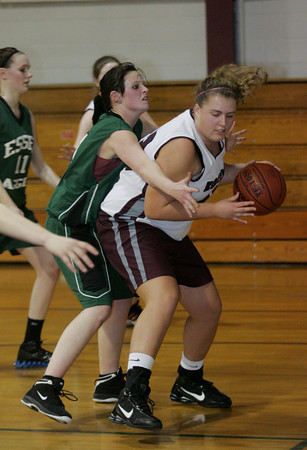 Rockport: Rockport's Emily Collins tries to break free from Essex Aggie defender Sharrie Volpe during the basketball game held at Stephen Rowell gymnasium Wednesday afternoon. Mary Muckenhoupt/Gloucester Daily Times