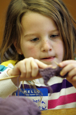 Essex: Isabella Thurlow, 6, of Essex work on her knitting while attending the knitting club at the TOHP Burnham Library Wednesday afternoon. The knitting club is held on Wednesdays from 3 to 5 p.m. for adults and children first grade and older with supplies and help provided. Isabella already knew a little about knitting from her mother Carleen who taught her the basics. Mary Muckenhoupt/Gloucester Daily Times