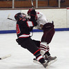 Gloucester: Gloucester's Connor Cranston and Marblehead's Ty Bates collide on the ice during their game at the Talbot Rink on Saturday night. Photo by Kate Glass/Gloucester Daily Times