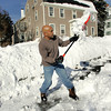 Gloucester: Stan Oshiro shovels out on Middle Street in Gloucester after about a foot of snow fell on Cape Ann Thursday afternoon.  The silver lining to this last storm was Thursday's weather made digging out not as cold. Mary Muckenhoupt/Gloucester Daily Times