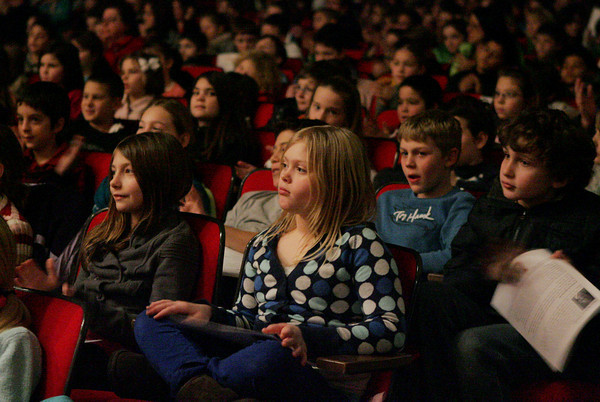 Gloucester: Allie Sears listens to the Cape Ann Symphony with her classmates form Plum Cove Elementary School during the youth outreach concert at the Fuller Auditorium Friday morning. Over 1,000 kids from Cape Ann towns came to watch the concert which included a demonstration of all the instruments in the orchestra. Mary Muckenhoupt/Gloucester Daily Times