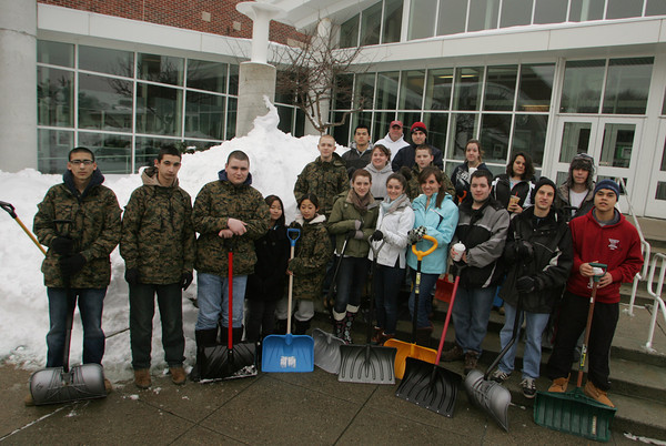 Gloucester: Gloucester High School students showed up at the high school Saturday mornign at 8 a.m. to donate their time to help those who are unable to shovel to clear their walkways and sidewalks. The students were taken by bus and dropped off at different locations in groups depending on how big the job was.  Mary Muckenhoupt/Gloucester Daily Times