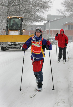 Gloucester: Caroline Moore goes crosscountry skiing down Pleasant Street ahead of her father Tom during the snow storm Wednesday afternoon. Mary Muckenhoupt/Gloucester Daily Times