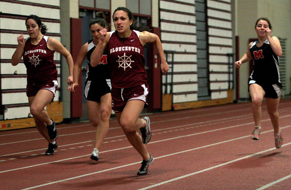 Gloucester: Gloucester's Emily Doucette sprints ahead of the race to win the short sprint during their meet against Marblehead in at the Benjamin A. Smith Fieldhouse yesterday. Photo by Kate Glass/Gloucester Daily Times