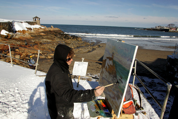 Rockport: Rockport artist Chris Coyne paints a winter scene with freshly fallen snow on his landscape at Front Beach Thursday afternoon. Coyne said it was nice weather for painting since it was warm enough that he didn't have to wear gloves. Mary Muckenhoupt/Gloucester Daily Times