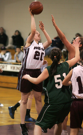 Rockport: Rockport's Liz Saville jumps over Essex Aggie defenders for a shot during the basketball game at Stephen Rowell gymnasium Wednesday afternoon. Mary Muckenhoupt/Gloucester Daily Times