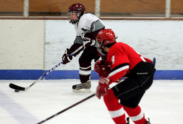Gloucester: Rockport's Brendan Surette skates ahead of an Amesbury defender during the hockey game at Dorothy Talbot Rink Wednesday night. Mary Muckenhoupt/Gloucester Daily Times