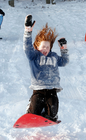 Rockport: Perry Wilson screams as she hits a jump while sledding at Evans Field yesterday. The field was packed with kids as Rockport had a snow day yesterday. Photo by Kate Glass/Gloucester Daily Times