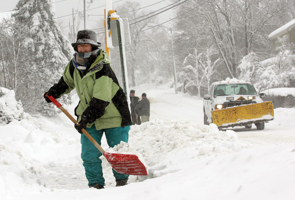 Manchester: Susan Costello shovels out her driveway on Lincoln Street during the snow storm Wednesday morning. This was Susan's first time out to shovel and she knew she would be back out before the storm was over. Mary Muckenhoupt/Gloucester Daily Times