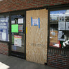 Manchester: One of the doors at Manchester Hardware has been boarded up following a robbery at the store over the weekend. Zak's Department store was also hit. Photo by Kate Glass/Gloucester Daily Times