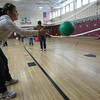Rockport: Valerie Wise, left, helps Ella Lorenz learn how to bump a volleyball during gym class at Rockport Elementary School yesterday. Wise and several of her fourth grade classmates stayed in from recess to help the kindergarten gym class. Photo by Kate Glass/Gloucester Daily Times