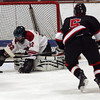 Gloucester: Gloucester goalie Mike Bresnahan dives on the puck during their game against Marblehead at the Talbot Rink on Saturday night. Photo by Kate Glass/Gloucester Daily Times