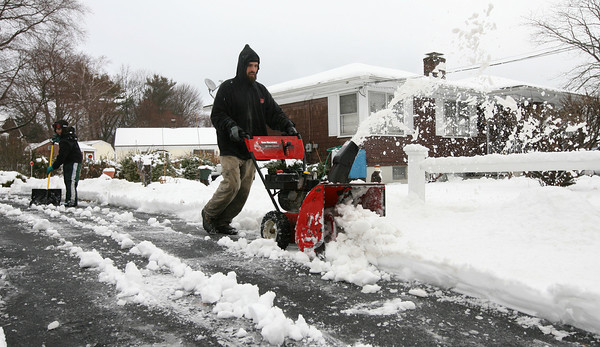 Rockport: Tom Prendergast and his daughter, Isabel, 10, help clear a neighbor's driveway on Summer Street following yesterday's snowstorm. Photo by Kate Glass/Gloucester Daily Times