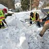 Essex: Essex firefighters, from left, Kevin Sousa, Barry Leeds and Eian Woodman dig out a fire hydrant on Eastern Avenue Saturday morning. Mary Muckenhoupt/Gloucester Daily Times