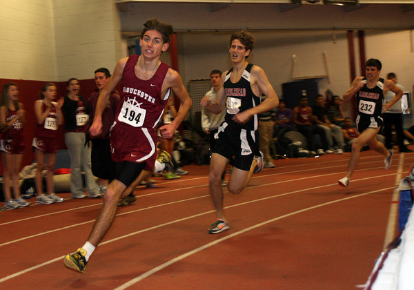 Gloucester: Gloucester's Noah Mondello sprints from third place to first in the last lap of the one mile race during their meet against Marblehead in at the Benjamin A. Smith Fieldhouse yesterday. Photo by Kate Glass/Gloucester Daily Times