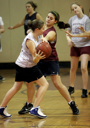 Rockport: Heather MacArthur tries to knock the ball from Abby Hood as the Rockport varsity and junior varsity scrimmage during practice yesterday. Their game against Essex Aggie was postponed for the second time due to weather. It is scheduled for next Wednesday. Photo by Kate Glass/Gloucester Daily Times