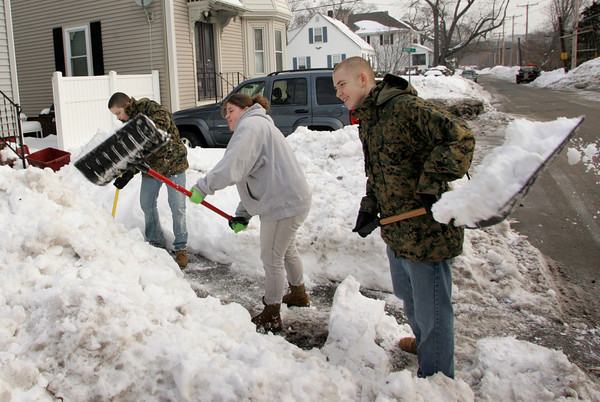 Gloucester: From right, Gloucester High School students Paul Bondarer, Sarah Taylor and Robert Spilman shovel the sidewalk and walkway of a home on Grove Street Saturday monring. About twenty students met at Gloucester High School Saturday morning and were bused to differnt addresses to shoevl for those who were unable to do so. Mary Muckenhoupt/Gloucester Daily Times