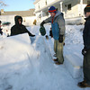 Rockport: Justus Dunton, Braely Jelmberg, Mike Akers, and Christian Kishida build a giant igloo on South Street yesterday afternoon. They started the igloo on Wednesday when the snow was slushy and were adding water to the snow to get the same consistency yesterday. Photo by Kate Glass/Gloucester Daily Times