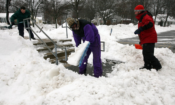 Rockport: Marc Brackett, Kenny Rowe, and Buddy Garlick clear snow from the Rockport school grounds yesterday so everything would be safe for school to reopen. Photo by Kate Glass/Gloucester Daily Times