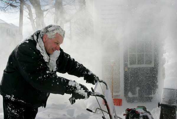 Gloucester: Joe Guzzo gets a coating of snow as he clears his driveway at his Washington Street home while on his lunch brake Thursday afternoon.  Cape Ann got about a foot of snow from this last storm making many weary of cleaning up snow. Mary Muckenhoupt/Gloucester Daily Times