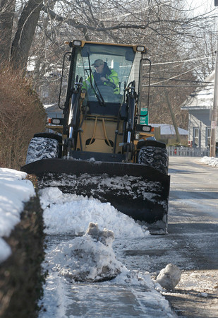 Rockport: Bill Aspesi of the Rockport Department of Public Works, removes snow from the sidewalk on Broadway in preparation for more snow, which is expected today. Photo by Kate Glass/Gloucester Daily Times