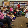 "Manchester: Larry Young plays a song based on a poem written by Ben Franklin during ""Ben Franklin's Musical Birthday Party"" at the Manchester Public Library on Saturday. Young told the story of Franklin's life and performed several songs related to the narrative. Photo by Kate Glass/Gloucester Daily Times"